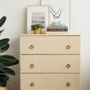 Bedroom dresser with Society6 artwork on top