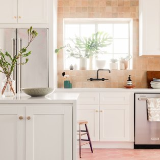 A light pink tile backsplash kitchen view