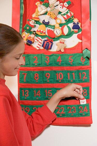 Girl with an advent calendar