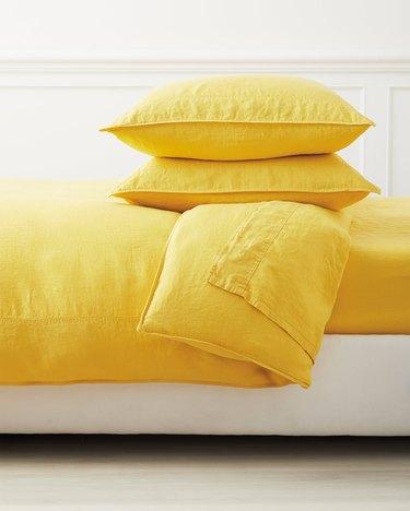 yellow linen duvet cover and pillows