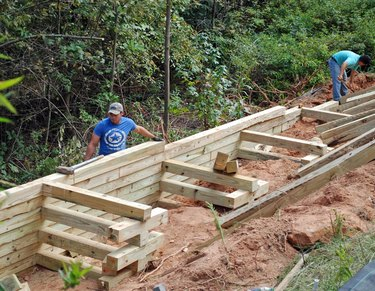wood retaining wall under construction