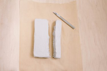 Strip of air dry clay cut from block with utility knife