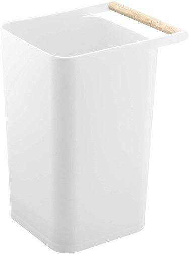 small plastic waste bin with wood handle
