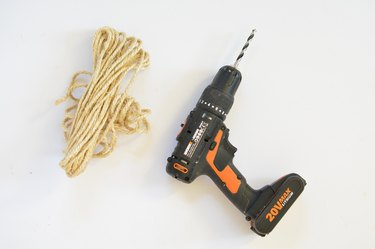 Power drill and a coil of sisal rope