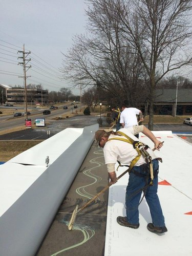 Installing TPO roofing.