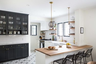 Scandinavian kitchen floor tile with black and white, paired with black cabinets