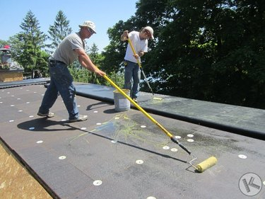 Installing undercoating for TPO roof.