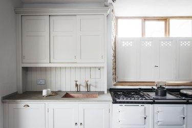 limestone countertops in white kitchen