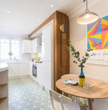 Scandinavian kitchen floor tile with pattern and white cabinets