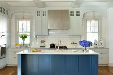 blue beadboard kitchen island with white countertop