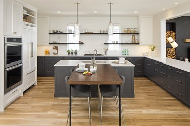 T-shaped kitchen island created with blue kitchen island and wood kitchen table