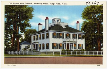 vintage photo of an old house with a widow's walk in Cape Cod, Massachusetts