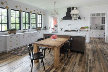 Rustic wood and quartz T-shaped kitchen island in farmhouse kitchen
