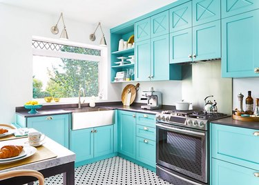 black and white kitchen floor tiles in turquoise kitchen