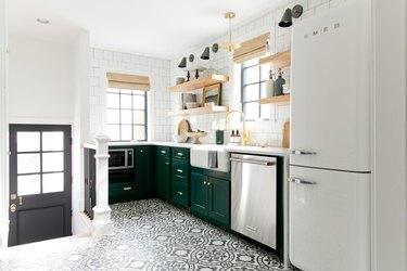 black and white kitchen floor tiles in green kitchen