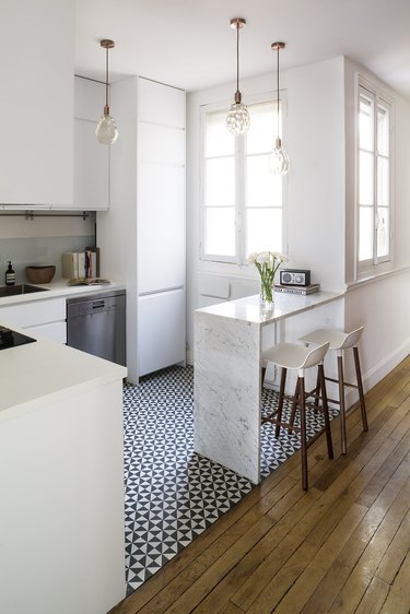 black and white kitchen floor tile with white cabinets