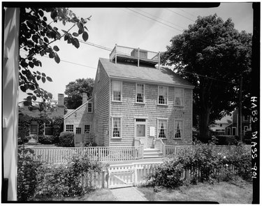 The Swain-Mitchell House in Nantucket featuring a rooftop scuttle and chimney