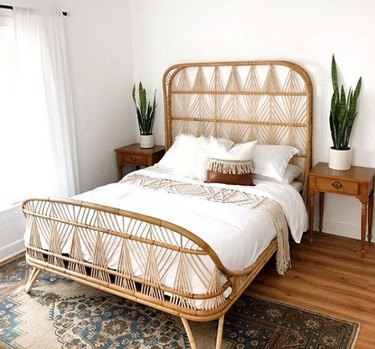 desert themed bedroom with geometric rattan bed frame
