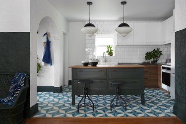 Moroccan kitchen floor tiles in blue pattern with wood cabinets