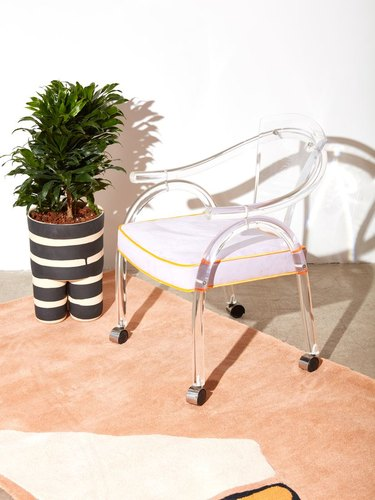 1970s Lucite Rolling Chair, $750