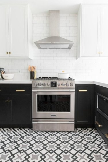 black and white Moroccan kitchen floor tiles with black cabinets and white countertops