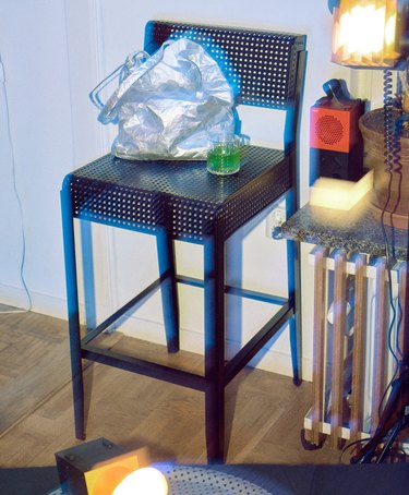 bar stool with green drink, end table with modular speaker