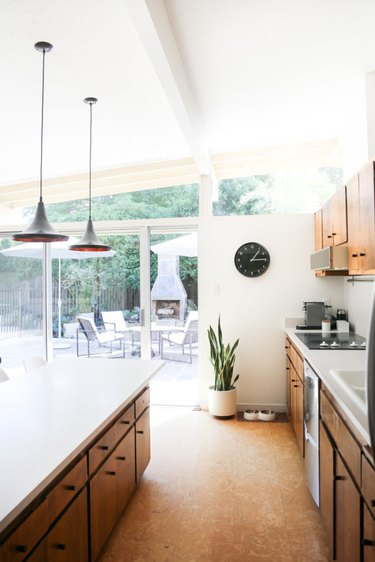kitchen space with hanging lighting fixtures and cork flooring