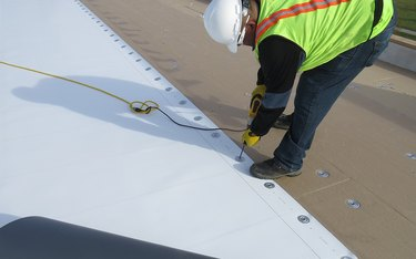 Installer securing TPO roofing.
