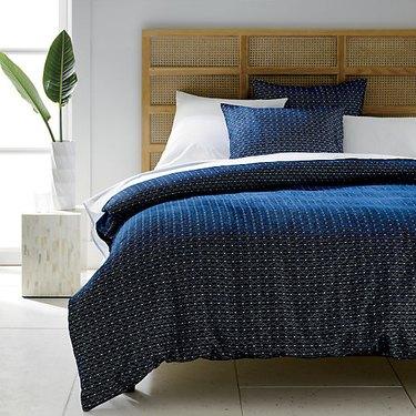 Scandinavian headboard with cane panels in bedroom