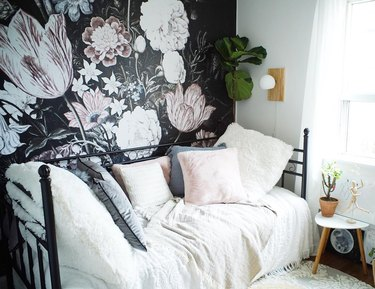 Removable wall mural with large pale pink and white flowers on black background
