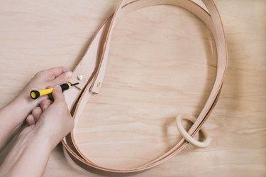 Adding brass brackets to leather