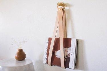 Hanging leather magazine holder