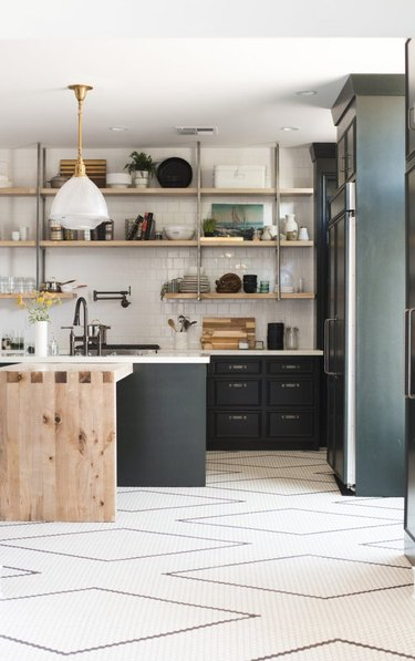 black and white kitchen floor with penny tile ini a diamond pattern