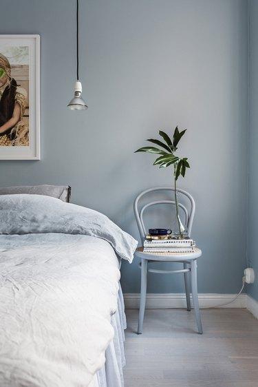 blue monochromatic bedroom with hanging pendant
