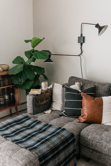 Drape the finished DIY tabletop over the arm of your sofa.