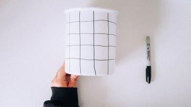 Drawn grid on jar