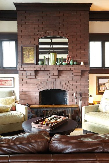 original red brick Craftsman style fireplace in living room