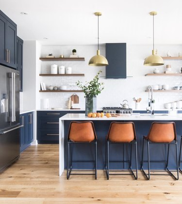 blue island with white waterfall countertop