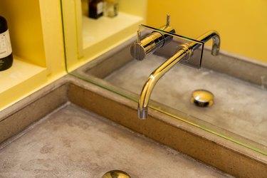concrete trough sink in bathroom