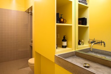 yellow bathroom with concrete sink