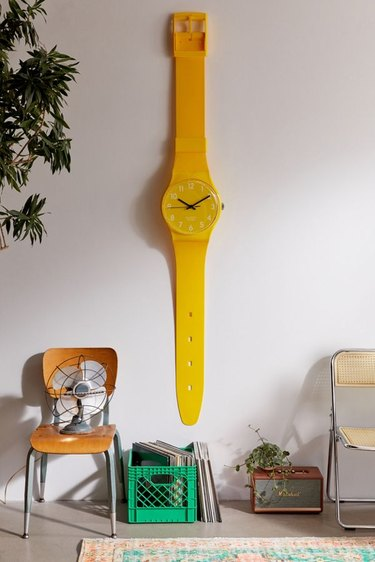 large yellow watch on wall near chair