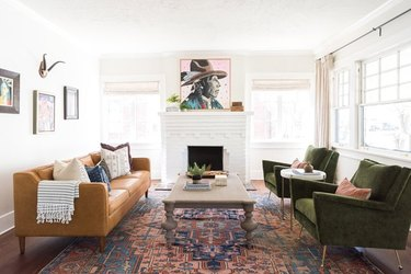 white painted brick Craftsman style fireplace in living room