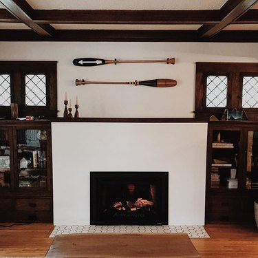 refaced Craftsman style fireplace with original built-ins