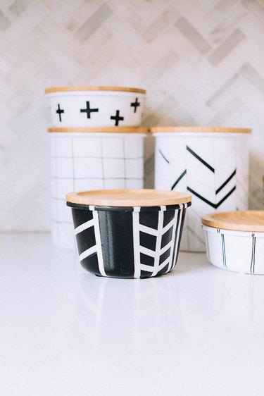 Black jar with white stripes
