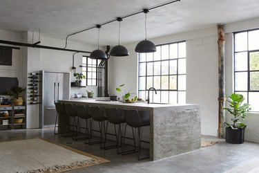 eco-friendly kitchen flooring in industrial space with concrete island