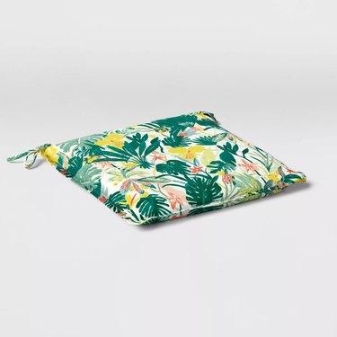 green tropical print outdoor seat cushion