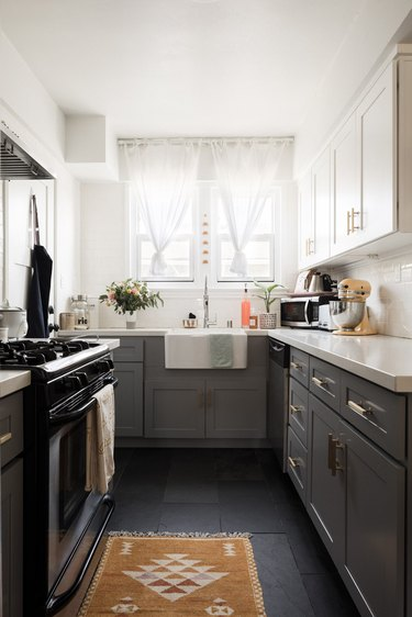 kitchen with gray cabinets and slate floors