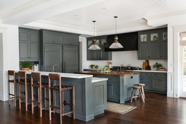 traditional kitchen lighting with green cabinets