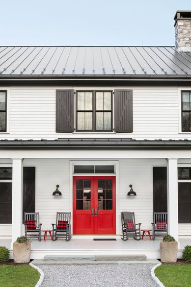 exterior of farmhouse style home with four chairs and red door