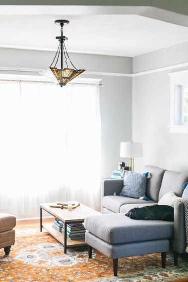 Craftsman living room with modern sofa and Tiffany ceiling light
